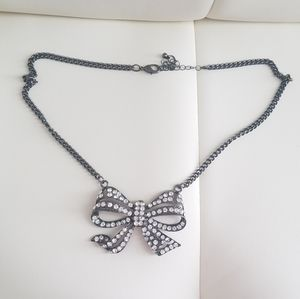 Gunmetal bow statement necklace